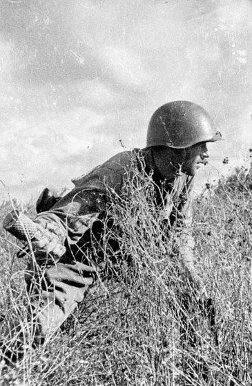 World War II, in Russia – the Great Patriotic War (22 June 1941 – 9 May 1945). Russian infantryman with a RGD-33 hand grenade. 1941. Photo by Victor A. Tyomin.
