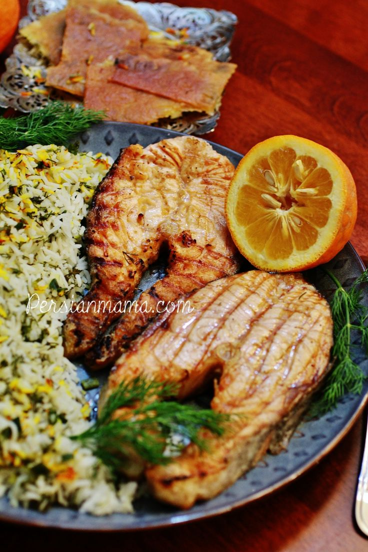 Sabzi Polo ba Mahi for Nowruz - Herbed rice with delicious grilled salmon steaks, flavored with a squeeze of Seville orange (narenj)