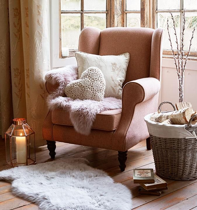 Subtle, dusty pinks create an effortless look in your living room. TOP TIP: adding cosy and warm sheepskin rugs to your sofas and chairs give your living room that added level of luxury.