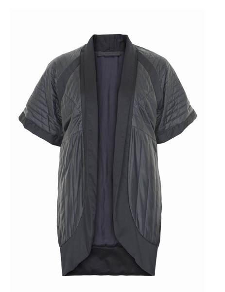 This statement piece makes an ideal accompaniment to the season's ladylike dresses. OR you can wear yours to the office with tailored pants, or at the weekend with skinny jeans or a pencil skirt and ballet flats.   100% silk   Two-toned black paneling details in deep black/antracit black.  Quilted silk - Short kimono sleeves -  round neck - open front - Deep in seam pockets. #Futuristic #fashion #minimalistic #danishdesign  Find it in our webshop:  www.butikbutik.dk  (or click on the piture)