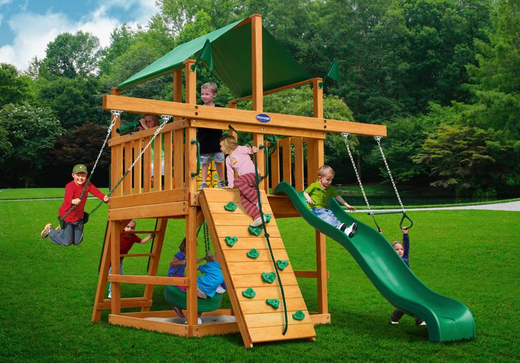 We think the Playnation Royal Palace Space Saver Wooden Swing Set is the best swing set for a small yard! Its footprint is minimized but not its features!