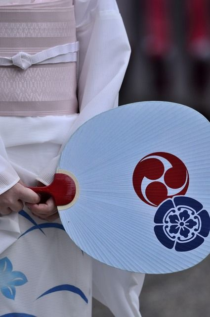 Japanese paper fan, Uchiwa 団扇 Kamon: Mokkoh in blue, and Mitsu-domoe in red. These kamons are both the sacred symbol of Yasaka Shrine, Gion, Kyoto.