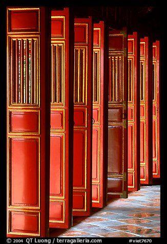 Red doors of the temple inside the Minh Mang Mausoleum. Hue, Vietnam