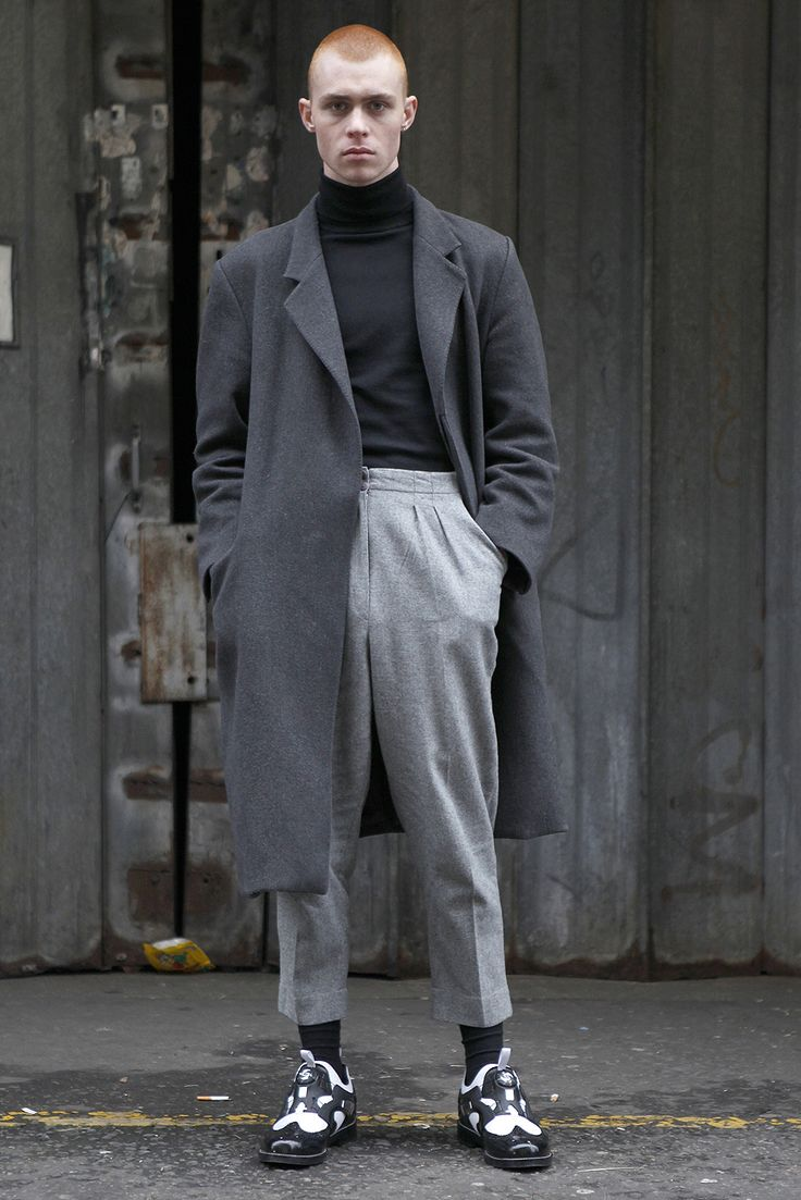 The monochrome colour and material contrasts give this softly tailored street style look the feel of athletic sportswear at London Collections: Men.