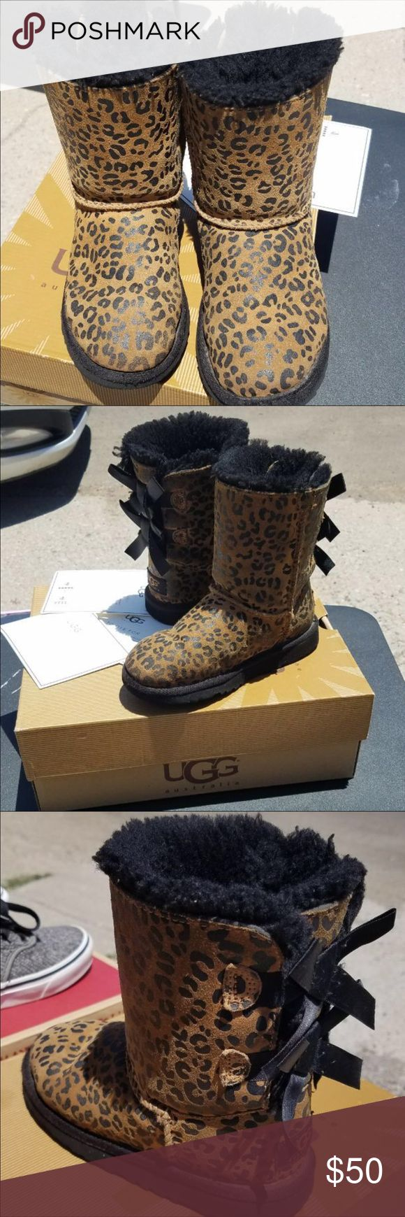 EUC little girls size 13 cheetah print UGG boots! EUC (no known flaws and in perfect condition) girls bailey bow cheetah/leopard print UGG boots in a size 13. Authentic UGGS- comes with original box and packaging. Super cute and rare boots- originally retail on Amazon for $150. UGG Shoes Boots