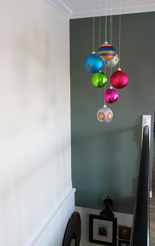 10 minutes to easy Christmas Cheer! Plastic ornaments, string, and tack to ceiling! #decorations #holidays