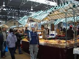 Old Spitalfields Market is a fine market hall. It has had a chequered history, http://bit.ly/HRjefj, supplying fruit and veg to London and now it is buzzing with shops, restaurants and stalls, http://bit.ly/Hg7vdJ.
