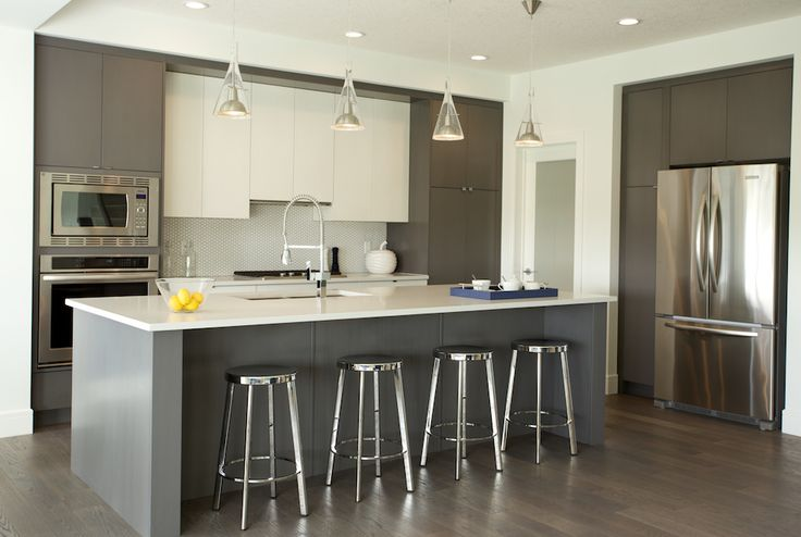 Builder Modern Showhome by Faria Interior Design.  Two tone modern kitchen cabinets.