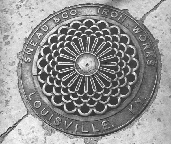 man hole covers on Main Street in Louisville, KY
