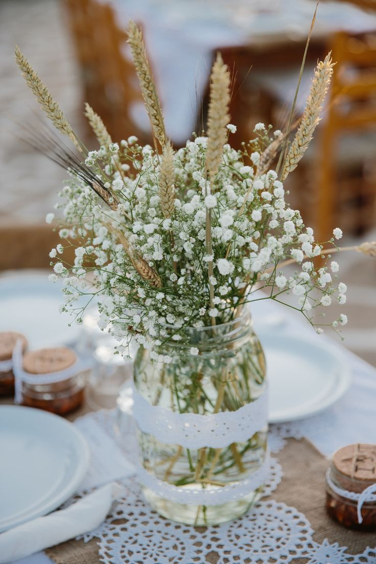 A wedding on Anafi Island | lafete, Greek wedding decoration, jar with dentelle, wheat, baby's breath, semen, simple wedding deco, Greek island wedding