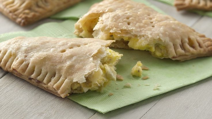 Breakfast on the run? Grab these tasty empanadas stuffed with eggs, cheese and salsa. Made with pie crust
