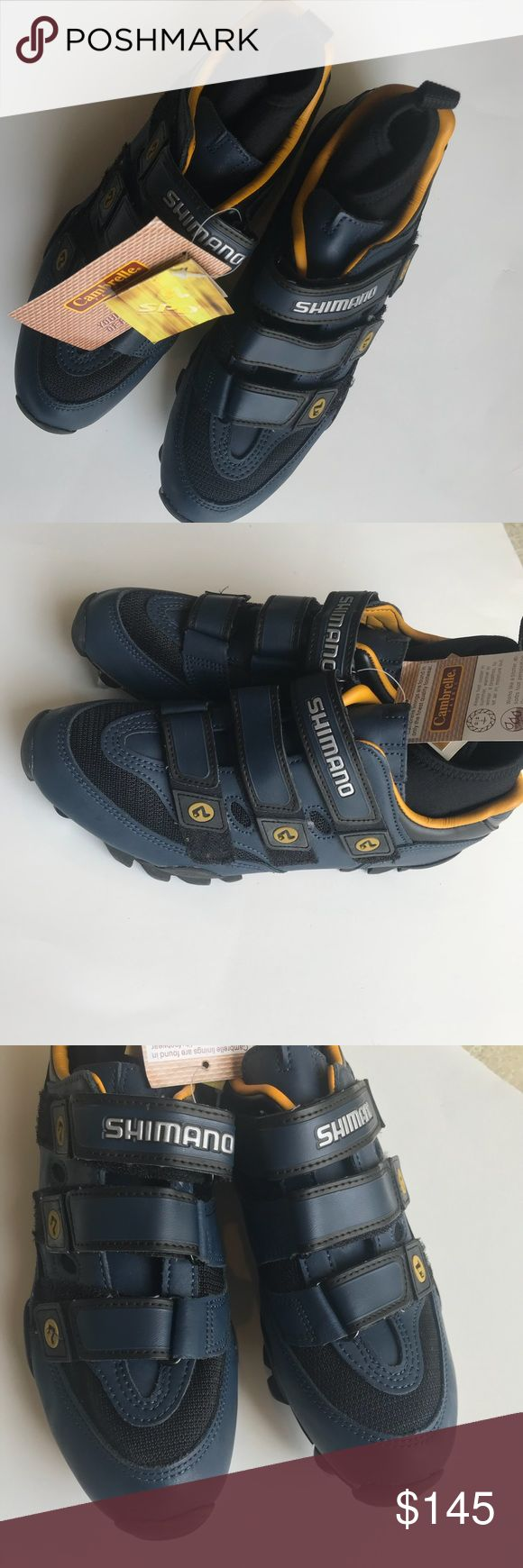 NWT cycling shoes Shimano 42 Euro 9.5 US Excellent condition. New with tags.                             Cambrelle fabric. Keeps feet cooler in summer and warmer in winter. It breathes to let air in moisture out.   Navy blue and black Shimano Shoes Athletic Shoes
