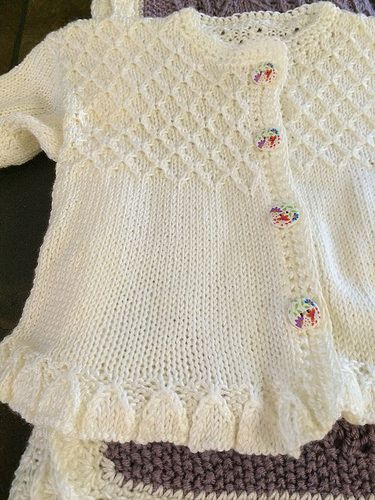 Ravelry: Project Gallery for Baby girls sweater with detailed bodice and frilled hemline and cuffs - P025 pattern by OGE Knitwear Designs