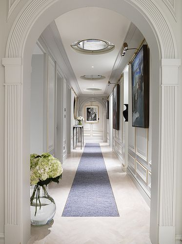 What a long elegant hallways with running, large built in lights and great curvature