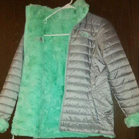 North face winter coat Brand new beutiful feather puffy onedise and polyester the other side reversable .grey and pastel green Limited edition .Brand new never worn , i still have the tag to it its just not attached .very unique , and very soft and warm. North Face Jackets & Coats Puffers