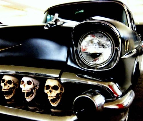 Something you don't see everyday - 57 Chevy with a grill full of skulls.