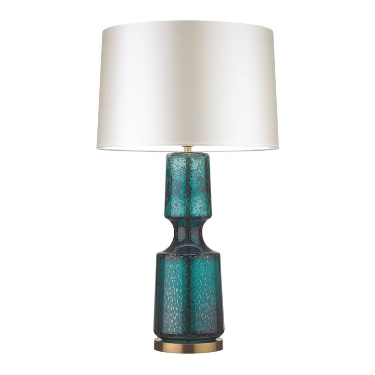 Heathfield+&+Co+Antero+Teal+Table+Lamp+-+Distressed+glass+teal+table+lamp+with+ivory+drum+shade.  Illuminate+the+beauty+of+your+interior+space+with+the+Heathfield+&+Co+Antero+Teal+Table+Lamp.  Featuring+a+beautifully+sculpted+form,+this+distinctive+mouth+blown+glass+table+lamp+celebrates+uniquely+intricate+bubble+detailing+and+concave+mid-section.  Striking+with+subtle+yet+vivid+appeal,+the+look+is+complete+with+antique+brass+detailing+for+a+layered+aesthetic+of+on-trend+rustic-meets-mod