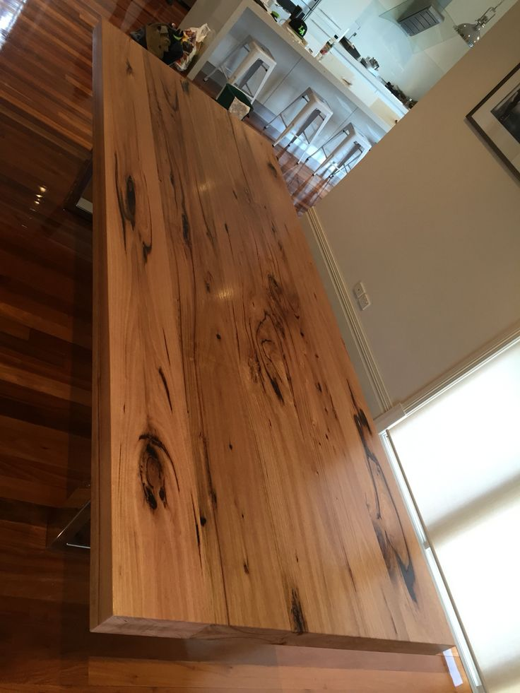 Hardwood timber dining table with stainless steel legs
