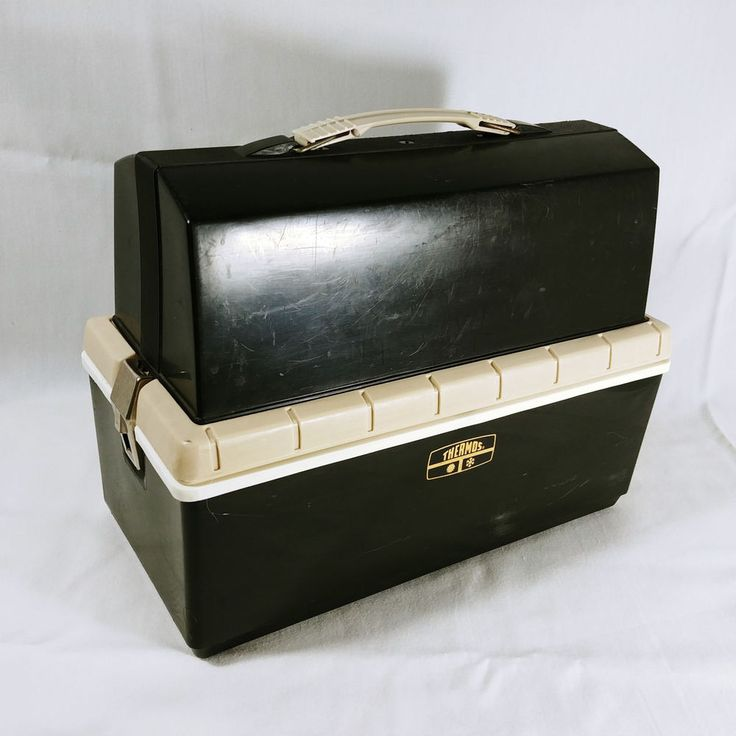 """Box has two sections. Insulated bottom for your lunch. Top carrying area for thermos of drinks. Box is about 12"""" by 5 1/2"""" by 9"""" tall. Will hold a thermos about 10 1/2"""" tall. Clips latch tight. 
