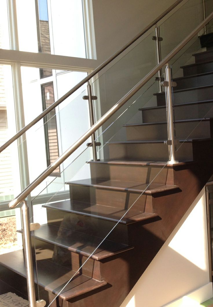 steel and glass are great compliments for stair railings