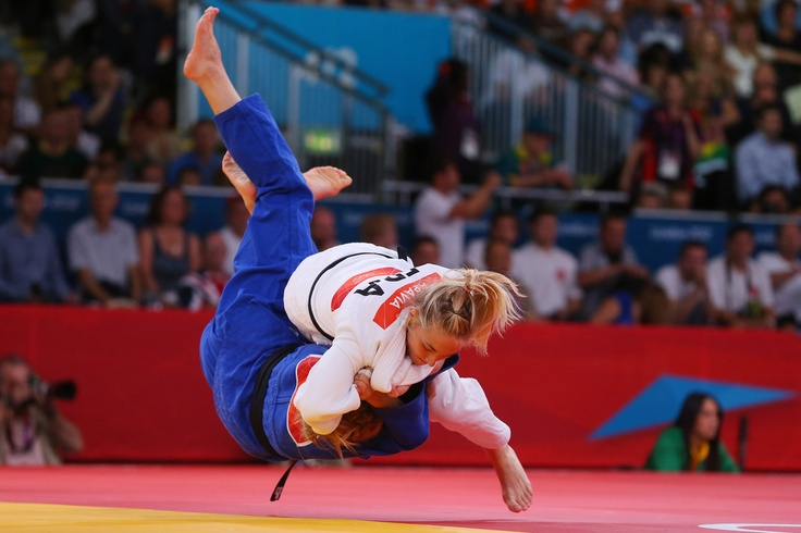 Automne Pavia of France (white) competes with Carli Renzi of Australia in the Women's -52 kg Judo on Day 3 of the London 2012 Olympic Games at ExCeL on July 30, 2012 in London, England.