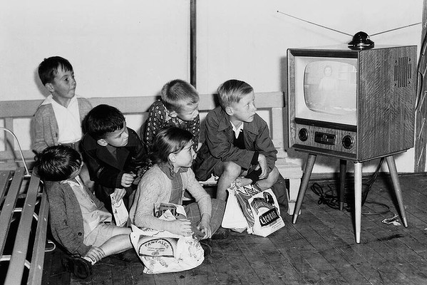 Children watch a television set on display at the Royal Easter Show, Sydney NSW Australia April 18, 1957 (for all the Australians...a Fantales showbag!! those were the days..lovely lollies...bet there's Minties and Jaffas in that bag as well, good old Allen's lollies)