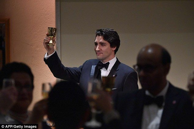 The youngest head of state of Commonwealth countries, Canadian Prime Minister Justin Trudeau, celebrates a toast in honour of The Queen