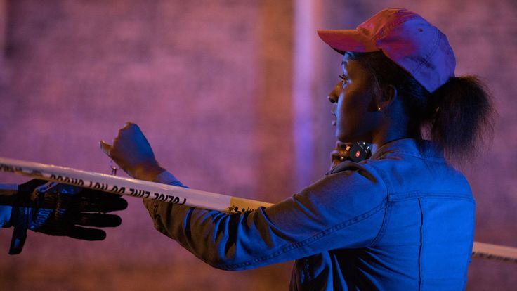 Violence leaves about 60 shot, 8 of them dead, for July 4th weekend  -  July 4, 2017:     Friday - East 73rd Street  -      A woman gives her keys to a Chicago police officer to retrieve something from her car at the scene where two people were shot in the 1000 block of East 73rd Street on June 30, 2017, in Grand Crossing.