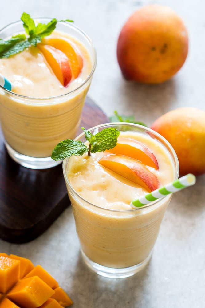 This healthy peach mango smoothie is vegan and the frozen fruit makes it thick and dessert like! Want to learn how to make the best smoothie? Get the exact proportions and my top tips for making smoothies too.