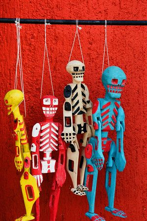 Colorful Skeletons for sale near the ruins of Tulum, Mexico on a very hot Yucatan summer day. by G Merritt