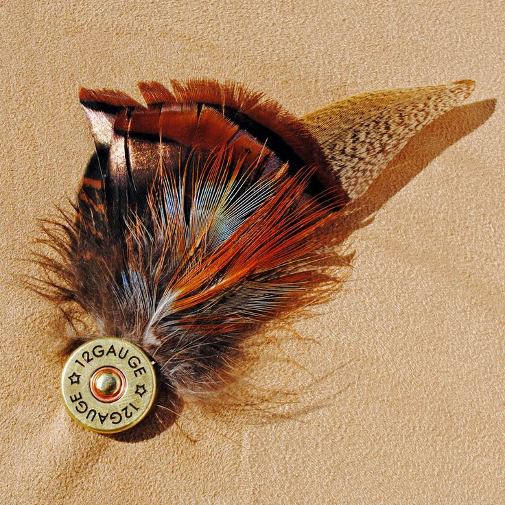 """Shotgun shell feather pin because all the men requested it...well here it is. Perfect for men and ladies for hunting hats or lapels or vests. Tie tack pin back. Actual shotgun shell is 3/4"""" in diamete"""