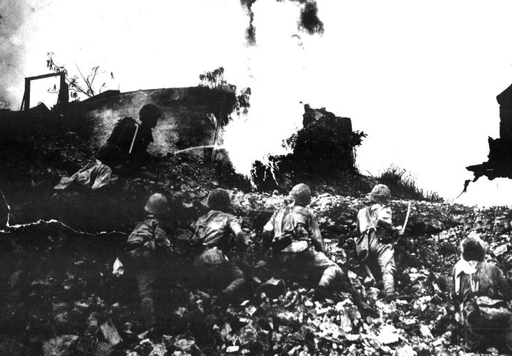 Japanese forces use flame-throwers while attacking a fortified emplacement on Corregidor Island, in the Philippines in May of 1942. (NARA