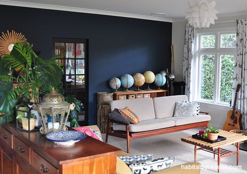 Fleur loves the current trend of dark walls, and was inspired to paint the living room in Resene Dark Knight. The ceiling and trims are painted in Resene Half Rice Cake.  http://www.habitatbyresene.co.nz/josh-and-fleur-go-to-town