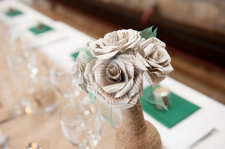 Roses made of book pages. Twine wrapped wine bottle vases. Homemade shabby shic, book themed wedding.