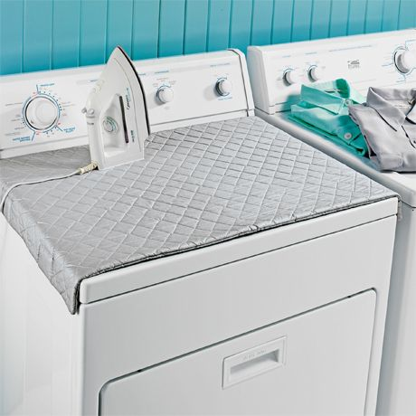 I love this quilted iron mat that magnetically adheres to your washer or dryer because who actually pulls out the ironing board these days?