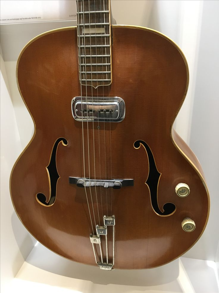 M300B (60) Mayfair Acoustic. Face: Canadian Spruce; Back and Sides: Maple; Fingerboard and Bridge: Rosewood. Introduced in 1960 and discontinued in 1964. A total of 175 were made.
