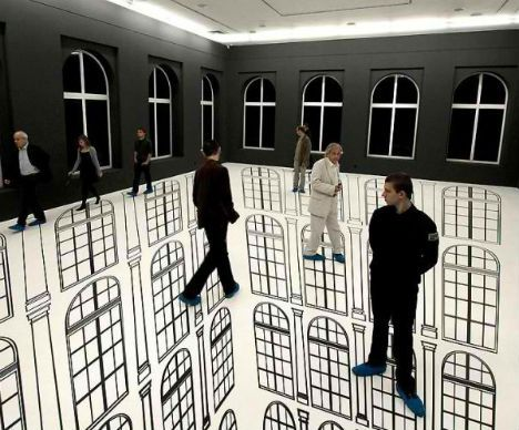 With some simple black markings that mimic the architecture of the gallery walls and windows, artist Regina Silveira makes visitors feel as if they're walking on air.