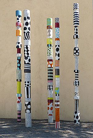 sally russell public art/sculpture inspiration. collaborative school sculpture with PAPER TUBES....each kids paints at least one with an awesome pattern...dowel rod display...