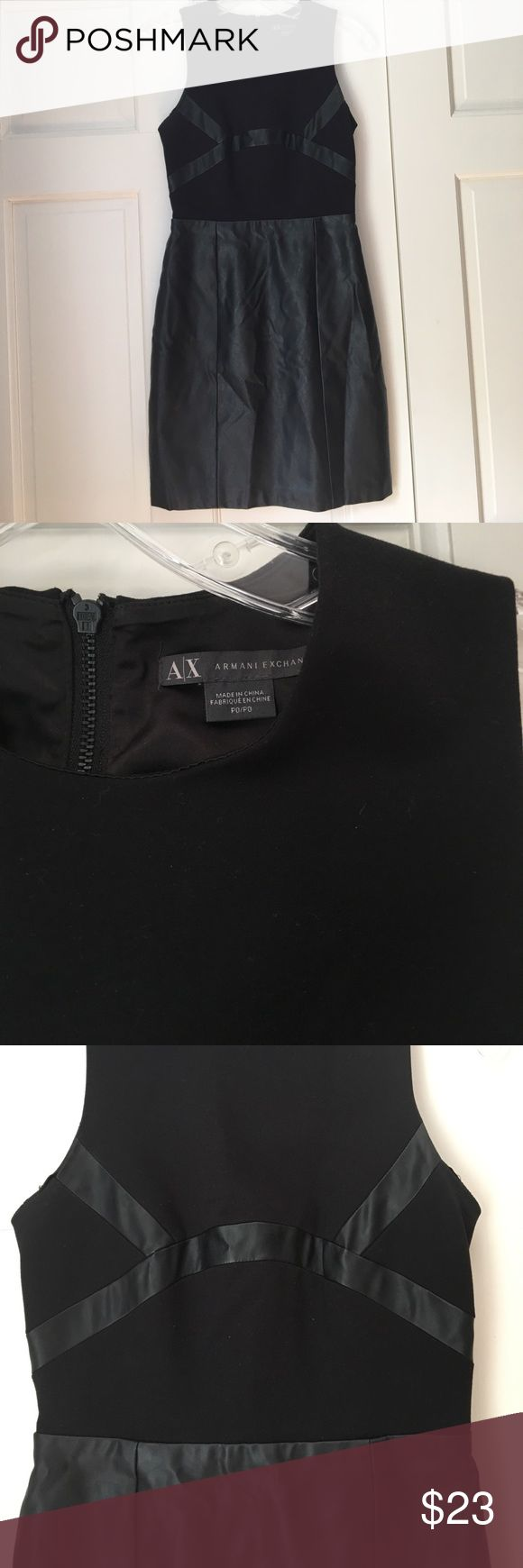 A/X Armani Exchange Black Faux Leather Dress A/X Armani Exchange Black Faux Leather Dress. Black dress with faux leather skirt and detailing at waist. A sleek dress for a night out. Worn, but in good condition. Petite 0. A/X Armani Exchange Dresses Mini