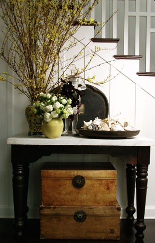 like the trunk idea, it would help cover up cords if you have lamps on the entry table