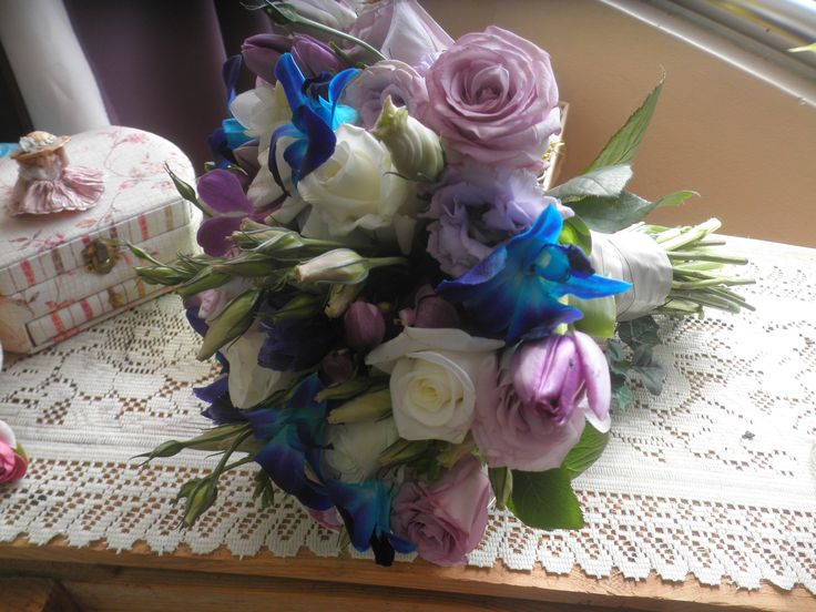 natural stem white roses purple roses blue singapore orchids