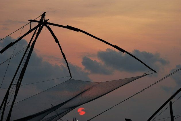 Chinese fishing nets against the sunset in Fort Kochi, Kerala.