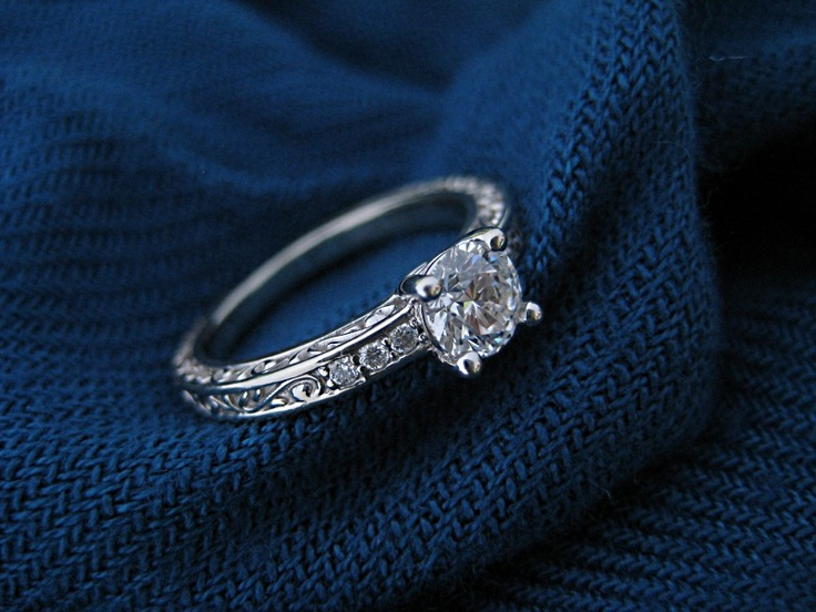 Clever ring shot of the Delicate Antique Scroll Ring