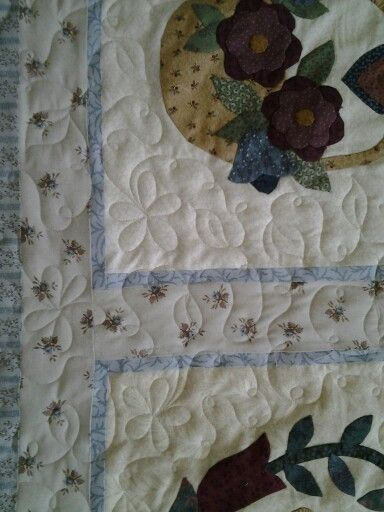 A nice bed quilt needed some flowers and loops.