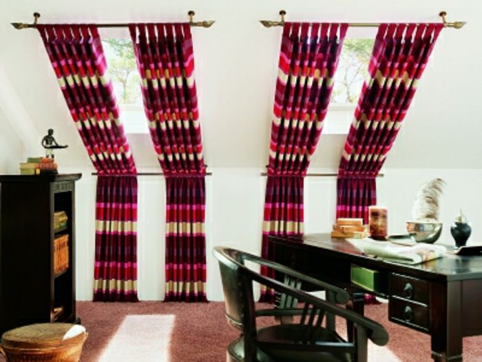 living room curtains ideas, dark green antique desk and chair, black cupboard and brown carpet, two sloping windows with curtains, with purple and pink, and red and cream stripes