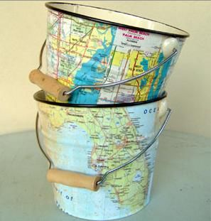 maps decoupaged on pails.