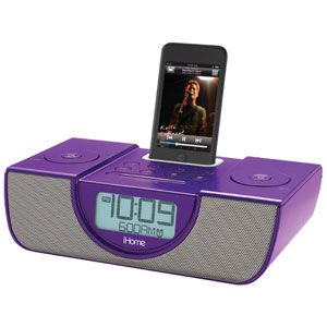 Save space—and wake up in time for class—with this funky purple iPod alarm clock and speaker system in one!