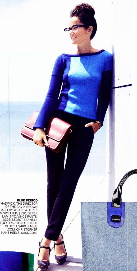 color block. cobalt blue + navy + top knot bun + oversized clutch