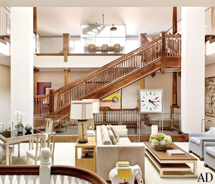 The grand central atrium created by combining two historic Boston townhouses into one expansive family home.