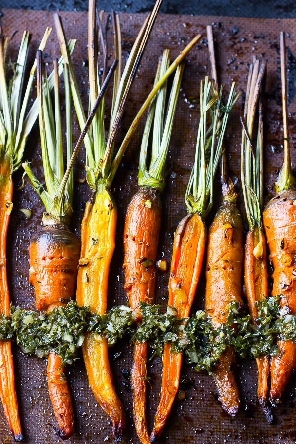 These Maple Garlic Roasted Carrots are incredibly tender, bursting with flavour and are topped with a delectable Carrot Greens Chimichurri.